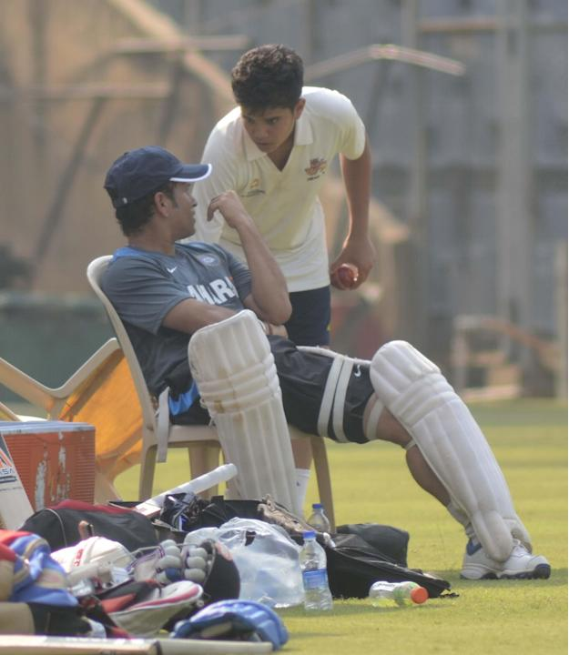 Indian cricketer Sachin Tendulkar with his son Arjun Tendulkar during practice session ahead of his 200th and last Test match at Wankhede stadium in Mumbai on Nov.12, 2013. (Photo: Sandeep Mahankaal/I