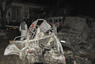 Destroyed vehicles remain at the site of a bomb attack in Quetta on January 10, 2013. Bomb attacks killed 92 people in Pakistan's city of Quetta on Thursday, as twin suicide bombers targeted a snooker hall frequented by Shiites in the deadliest single attack in the country for nearly two years