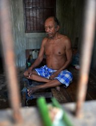 Nengah Surung, a 65-year-old schizophrenic patient, sits in his room in Karangasem. He lives in a government-built three-by-four-metre concrete cell with a barred door and window. His home prison reeks of faeces and urine