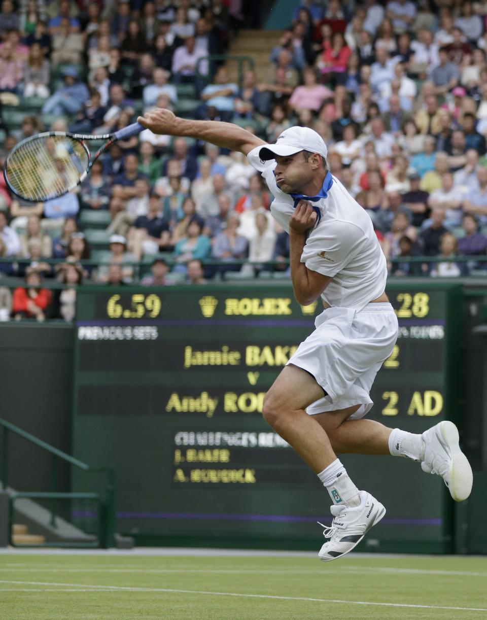 Andy Roddick of the United States returns a shot against Jamie Baker of Britain during a first round men's singles match at the All England Lawn Tennis Championships at Wimbledon, England, Tuesday, June 26, 2012. (AP Photo/Tim Hales)