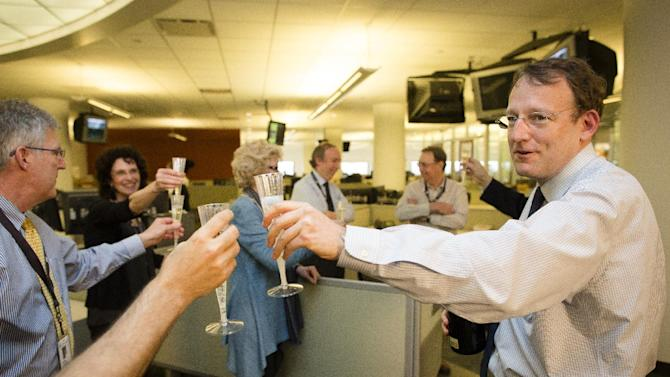 Santiago Lyon, Director of Photography and Vice President, toasts with champagne after announcing their Associated Press photographers Rodrigo Abd, Manu Brabo, Narciso Contreras, Khalil Hamra,, and Muhammed Muheisen won the the 2013 Pulitzer Prize for Breaking News Photography for their work covering the Syrian civil war, Monday, April 15, 2013, in New York. (AP Photo/John Minchillo)