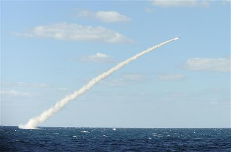 A South Korean navy submarine launches an indigenous cruise missile during a drill at an undisclosed location in this picture released by the navy in Seoul