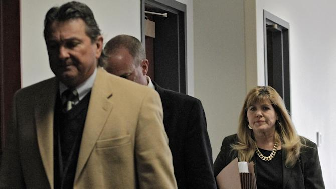Assistant district attorney Karen Pearson, right, and members of the prosecution team  arrive for a hearing for Aurora theater shooting suspect James Holmes at the courthouse in Centennial, Colo., on Wednesday, April 10, 2013. (AP Photo/Ed Andrieski)