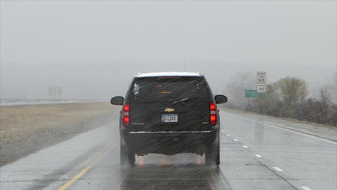 In this Nov. 2, 2011, photo a black SUV carrying Iowa Gov. Terry Branstad, and a police escort, unseen in front, travel a reopened stretch of Interstate 680 that had been closed by flooding. A trooper pursued the same state vehicle carrying Iowa Gov. Terry Branstad on April 26 that was speeding 90 miles per hour on an Iowa highway, but declined to pull the driver over after realizing who was in the vehicle, according to records released Tuesday, July 2, 2013.. (AP Photo/Nati Harnik)