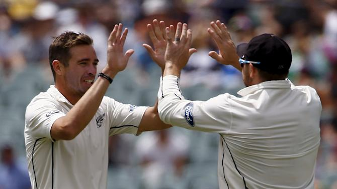 New Zealand's captain Brendon McCullum celebrates with team mate Tim Southee after he ran out Australia's Shaun Marsh for two runs during the second day of the third cricket test match at the Adelaide Oval, in South Australia