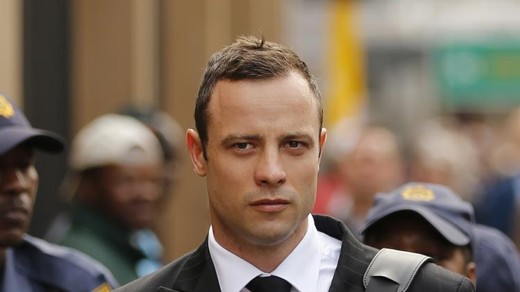 Olympic and Paralympic track star Pistorius arrives ahead of his trial for the murder of his girlfriend Steenkamp, at the North Gauteng High Court in Pretoria