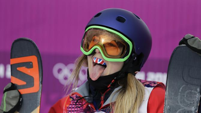 Britain's Katie Summerhayes pokes her tongue out after a run in the women's freestyle skiing slopestyle qualifying at the Rosa Khutor Extreme Park at the 2014 Winter Olympics, Tuesday, Feb. 11, 2014, in Krasnaya Polyana, Russia