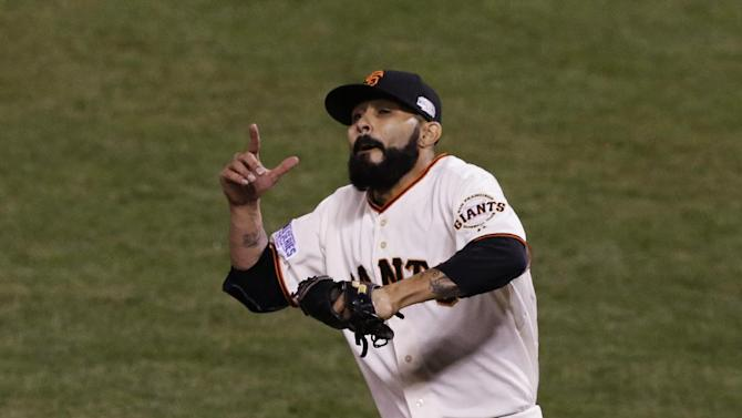 San Francisco Giants pitcher Sergio Romo reacts after the eighth inning of Game 4 of baseball's World Series against the Kansas City Royals Saturday, Oct. 25, 2014, in San Francisco. (AP Photo/Jeff Chiu)