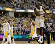 Indiana Pacers's Darren Collison celebrates after hitting a fourth quarter three pointer during the game against the Orlando Magic on May 8. Indiana won 105-87 in game five of their Eastern Conference series
