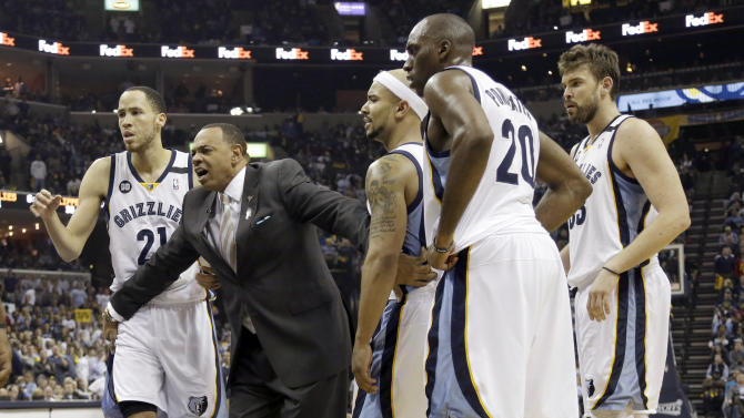 Memphis Grizzlies coach Lionel Hollins, second from left, restrains players Tayshaun Prince (21), Jerryd Bayless, Quincy Pondexter (20) and Marc Gasol, far right, after tempers flared during the first half of Game 6 in a first-round NBA basketball playoff series against the Los Angeles Clippers in Memphis, Tenn., Friday, May 3, 2013. The Grizzlies defeated the Clippers 118-105. (AP Photo/Danny Johnston)