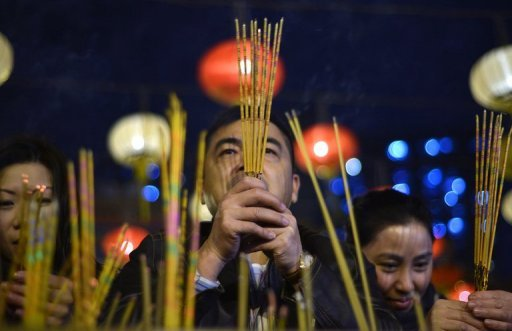Worshippers place incense sticks as they pray to welcome in the Lunar New Year, in Hong Kong, on February 9, 2013