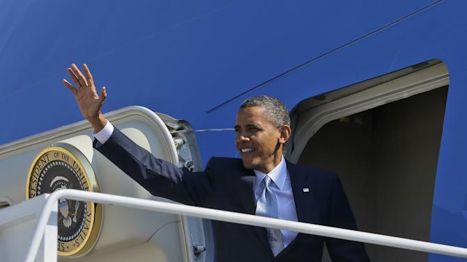 President Barack Obama waves as he boards Air Force One before his departure from Andrews Air Force Base, Sunday, Sept., 30, 2012. Obama is traveling to Las Vegas for a campaign rally then will be staying in Nevada to prepare for the first presidential debate with Republican rival, former Massachusetts Gov. Mitt Romney, on Wednesday, Oct. 3, 2012. (AP Photo/Pablo Martinez Monsivais)