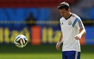 Argentina's Messi looks at the ball during a team training session at the national stadium in Brasilia
