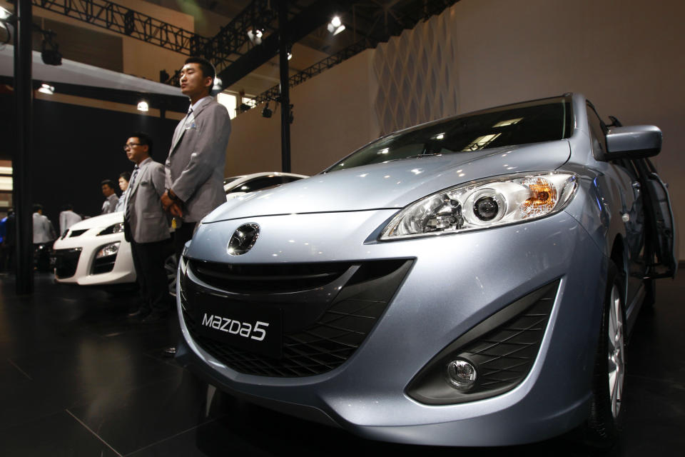 Mazda's Mazda5 is on displays at the Beijing International Auto Exhibition in Beijing, China, Monday, April 23, 2012.  (AP Photo/ Vincent Thian)