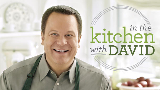 """In this undated publicity image provided by The Random House Publishing Group, the cover of David Venable's book, """"In the Kitchen with David,"""" (Ballantine Books, an imprint of The Random House Publishing Group) is shown. Having a popular show on QVC, the shopping network. Dave Venable, QVC's self-proclaimed resident foodie, spends at least six hours a week on the air, and his fans are now pre-ordering his debut cookbook of comfort food, with recipes like cheesy cheeseburger casserole and bacon-topped mac 'n cheese, in numbers that resemble a hot new novel.  (AP Photo/The Random House Publishing Group)"""