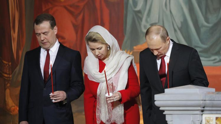 Russian President Putin, PM Medvedev and his wife Svetlana attend an Orthodox Easter service in the Christ the Saviour Cathedral in Moscow