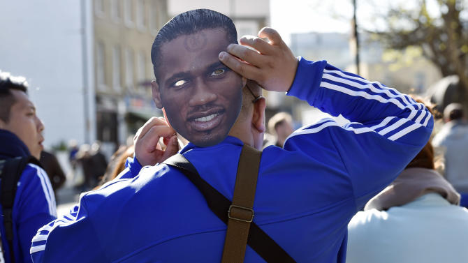Football: Chelsea fan outside the stadium before the game with a Didier Drogba mask