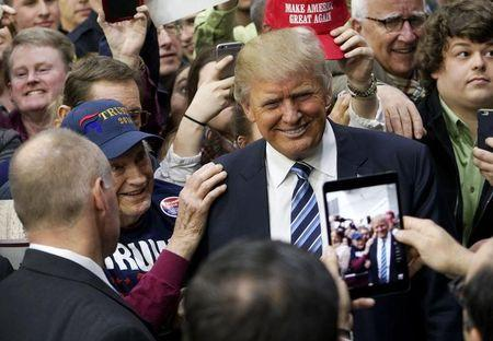 U.S. Republican presidential candidate Trump poses for a photo with a supporter after a campaign rally in Plymouth