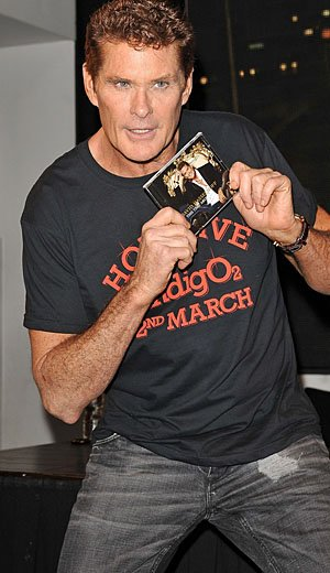 David Hasselhoff signs albums. (AWAIS; PacificCoastNews.com)