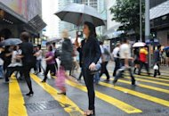 French expatriate Annie Pudlo stands on a street in Hong Kong&#39;s Central district. The number of French expatriates in the East have been growing faster than anywhere else: 11% last year including 22% in Indonesia and 11.4% in China, according to French government figures