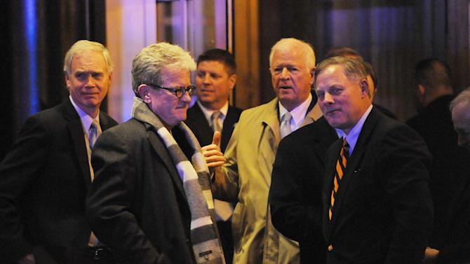 FILE -In this March 6, 2013, file photo Republican Senators, including Ron Johnson, R-Wis., Tom Coburn, R-Okla., Richard Burr, R-N.C., and Saxby Chambliss, R-Ga., leave the Jefferson Hotel after a dinner with President Barack Obama in Washington. Each on the others' home turf over three days Obama hosted dinners and lunches and visited Capitol Hill in his outreach effort with Congressional Republicans, making what seemed like an attempt to work together. In reality however the past few weeks have simply shone the spotlight on the tension of this nation's say-one-thing-do-the-other politics.  (AP Photo/Olivier Douliery, Pool)