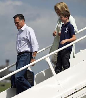 Republican presidential candidate, former Massachusetts Gov. Mitt Romney, his wife Ann, and their grandson Joe, arrive at Tampa International Jet Center, Tuesday, Aug. 28, 2012, in Tampa, Fla.  (AP Photo/Evan Vucci)