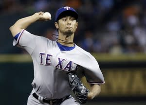 Texas Rangers' Yu Darvish delivers against the Houston Astros in the first inning of a baseball game Tuesday, April 2, 2013, in Houston. (AP Photo/Pat Sullivan)