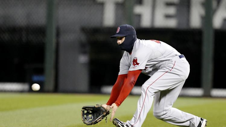 Boston Red Sox right fielder Daniel Nava makes a shoestring catch on a fly ball hit by Chicago White Sox's Marcus Semien during the seventh inning of a baseball game Tuesday, April 15, 2014, in Chicago. (AP Photo/Charles Rex Arbogast)