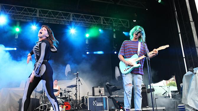 """FILE - This May 18, 2013 file photo shows Hannah Hooper, left, and Christian Zucconi of Grouplove performing as part of Party in the Park at Centennial Olympic Park in Atlanta. Grouplove's, """"Ways to Go,"""" was the most viral track on Spotify, from Monday, June 10, to Sunday, June 16, via Facebook, Tumblr, Twitter and Spotify.  (Photo by Robb D. Cohen/RobbsPhotos/Invision/AP, file)"""