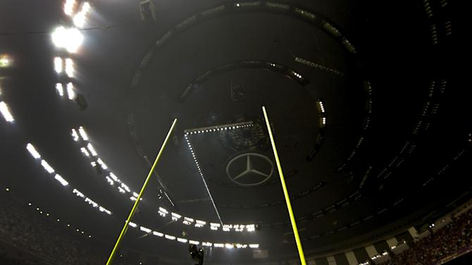 A power outage affects about half the lights in the Superdome during the second half of the NFL Super Bowl XLVII football game between the San Francisco 49ers and the Baltimore Ravens, Sunday, Feb. 3, 2013, in New Orleans. (AP Photo/Dave Martin)