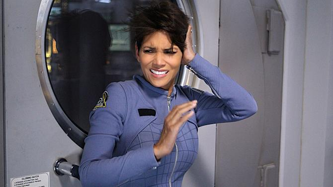 """FILE - This file image released by CBS shows Halle Berry in a scene from the series """"Extant."""" The limited run series, in which Berry plays an astronaut who mysteriously returns from a solo space mission pregnant, had 9.6 million viewers for its first episode on CBS last week, the Nielsen company said. That was enough to make it the most-watched prime-time show during the week. (AP Photo/CBS, Sonja Flemming, File)"""