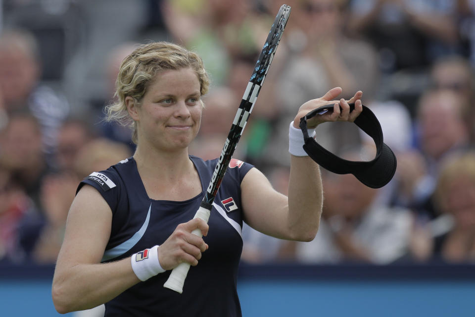 Kim Clijsters of Belgium celebrates winning her match against Kateryna Bondarenko of the Ukraine at the Unicef Open grass court tennis tournament in Rosmalen, central Netherlands, Tuesday, June 19, 2012. Clijsters won in two sets 6-2, 6-1. (AP Photo/Peter Dejong)