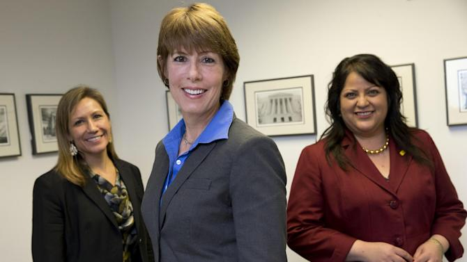 """In this April 30, 2014 photo, female House congressional candidates Amanda Renteria, D-Calif., left, Gwen Graham, D-Fla., center, daughter of former Florida senator and governor Bob Graham, and Roxanne """"Rocky"""" Lara, D-N.M., pose for a photo at the Democratic Campaign Committee in Washington. Democrats, after robust recruiting of female candidates, are counting on women to knock out a few GOP candidates in the 2014 midterm elections. (AP Photo/Jacquelyn Martin)"""