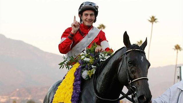 Brian Hernandez Jr celebrates after Fort Larned's victory in the Breeders' Cup Classic at Santa Anita Park (Reuters)