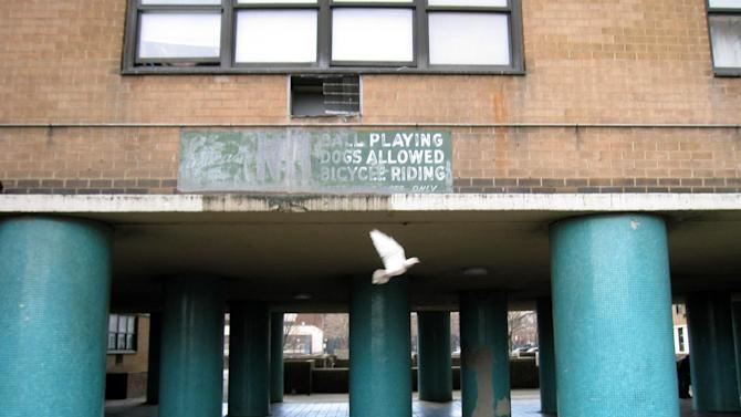 "This April 7, 2013 image shows the former site of the Brooklyn Dodgers' ballpark, Ebbets Field, which was torn down after the Dodgers moved to Los Angeles in 1957 and is today an apartment complex in the Crown Heights neighborhood.  A faded sign in the courtyard says ""No ball playing.""  A new movie, ""42,"" tells the inspiring story of how Jackie Robinson integrated Major League Baseball when he played here for the Dodgers, beginning in 1947. (AP Photo/Beth J. Harpaz)"