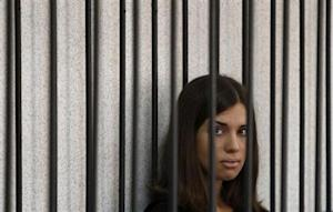 """Member of the female punk band """"Pussy Riot"""" Tolokonnikova looks out from a holding cell as she attends a court hearing to appeal for parole at the Supreme Court of Mordovia in Saransk"""