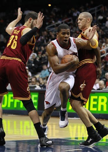 Johnson scores 25 as Hawks roll past Cavs 121-94