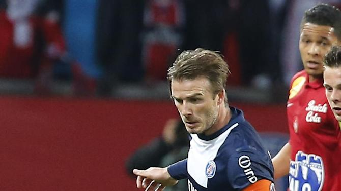 Paris Saint Germain's David Beckham in action during his French League One soccer match against  Brest, at Parc des Princes  Stadium, in Paris, Saturday, May 18, 2013. Paris Saint-Germain hopes to strike a deal with David Beckham in the next two weeks in which the former England captain will work with the French club after retirement, possibly in an ambassadorial role. (AP Photo/Jacques Brinon)