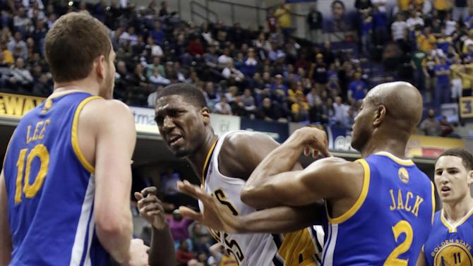 Indiana Pacers center Roy Hibbert, center, is pushed by Golden State Warriors guard Jarrett Jack (2) during an altercation with Warriors forward David Lee (10) during the second half of an NBA basketball game in Indianapolis, Tuesday, Feb. 26, 2013. Lee received a technical foul; Hibbert received two technical fouls and was ejected from the game. The Pacers won 108-97. (AP Photo/AJ Mast)