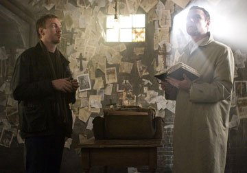 David Thewlis as Jennings and Liev Schreiber as Thorn in 20th Century Fox's The Omen
