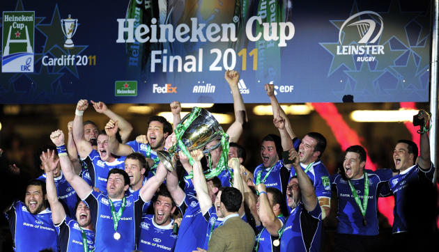 Leinster players celebrate with the trophy after winning their Heineken Cup Final match against Northampton Saints at the Millennium Stadium, Cardiff, Wales, on May 21, 2011. AFP PHOTO/GLYN KIRK  NOT