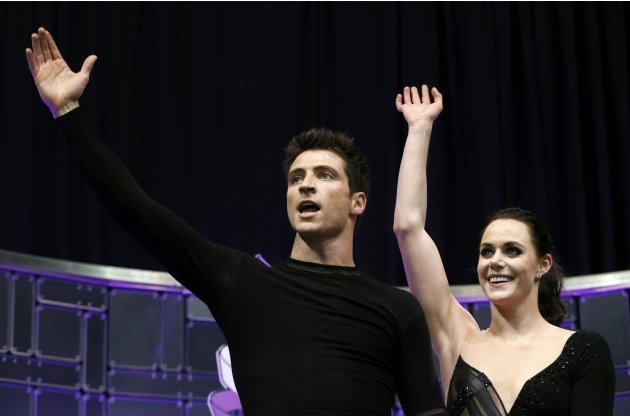 Virtue and Moir of Canada wave to the crowd after their ice dance free dance at the ISU World Figure Skating Championships in London, Ontario
