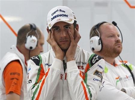 Sahara Force India Formula One driver Sutil of Germany covers his ears during the first practice session of the South Korean F1 Grand Prix in Yeongam