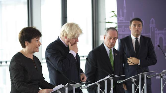 From right, Florence Mayor Matteo Renzi, New York Mayor Michael Bloomberg, London Mayor Boris Johnson, and Warsaw Mayor Hanna Gronkiewicz-Waltz, during the launch of the Mayors Challenge competition, at City Hall in London, Tuesday, Sept. 24, 2013. New York Mayor Michael Bloomberg is offering European cities millions of dollars to be government groundbreakers, tapping his personal fortune to extend his cities-as-civic-laboratories campaign overseas as the end of his own tenure nears. (AP Photo/Matt Dunham)