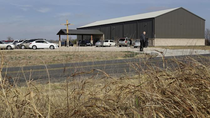 A person stands at the entrance of a parking lot as he waits to direct traffic into the location as mourners arrive at Ridgeview Family Fellowship Church for the funeral service of Kasandra Perkins, Thursday, Dec. 6, 2012, in Blue Ridge, Texas. Perkins was shot and killed last Saturday by her boyfriend Jovan Belcher, a Kansas City Chiefs football player. AP Photo/Tony Gutierrez)