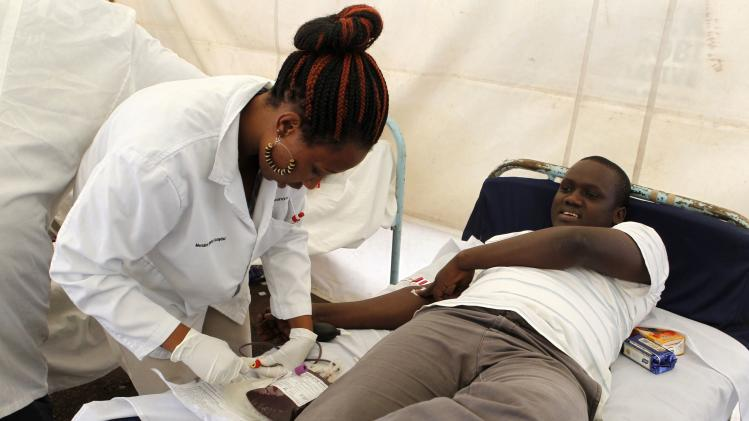 A man donates blood at a temporary donation centre for victims of a shopping mall shooting spree in Nairobi