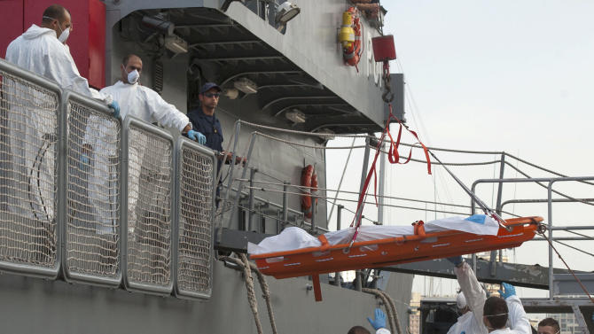 FILE - In this Saturday, Oct. 12, 2013 file photo, a body is lowered down from a Maltese Navy ship at the Valletta harbor, Malta after a Maltese ship brought 143 survivors from a capsized smugglers' boat after 34 people drowned when the boat capsized. Most of the migrants in the latest tragedy were fleeing civil war in Syria. A sharp rise in the number of Syrians attempting the perilous sea voyage over the past three months highlights the crushing life-and-death decisions facing many who fled to Egypt to escape Syria's armed conflict, according to rights group Amnesty International.. (AP Photo/Lino Arrigo Azzopardi, File)