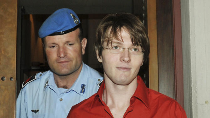 FILE - In this June 26, 2009 file photo, murder suspect Raffaele Sollecito is escorted by a penitentiary police officer as he arrives for a hearing in the Meredith Kercher murder trial, in Perugia, Italy. Sollecito, whose budding love affair with American exchange student Amanda Knox helped land him in an Italian prison for four years, maintains the couple's innocence in a new book but acknowledges that their sometimes bizarre behavior after her roommate's killing gave police reason for suspicion. (AP Photo/Stefano Medici, File)