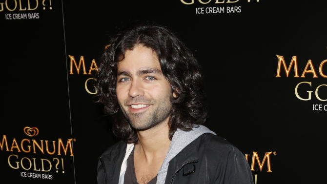 Actor Adrian Grenier arrives on the gold carpet of the 'As Good As Gold' premiere, a new short film starring Joe Manganiello that celebrates the U.S. arrival of MAGNUM Gold?! Ice Cream. The film debuted during the Tribeca Film Festival Thursday, April 18, 2013 in New York. Visit MagnumIceCream.com for more information  (Photo by Jason DeCrow/Invision for MAGNUM/AP Images)