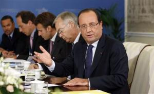 French President Francois Hollande speaks during a meeting with U.S. President Barack Obama in St. Petersburg